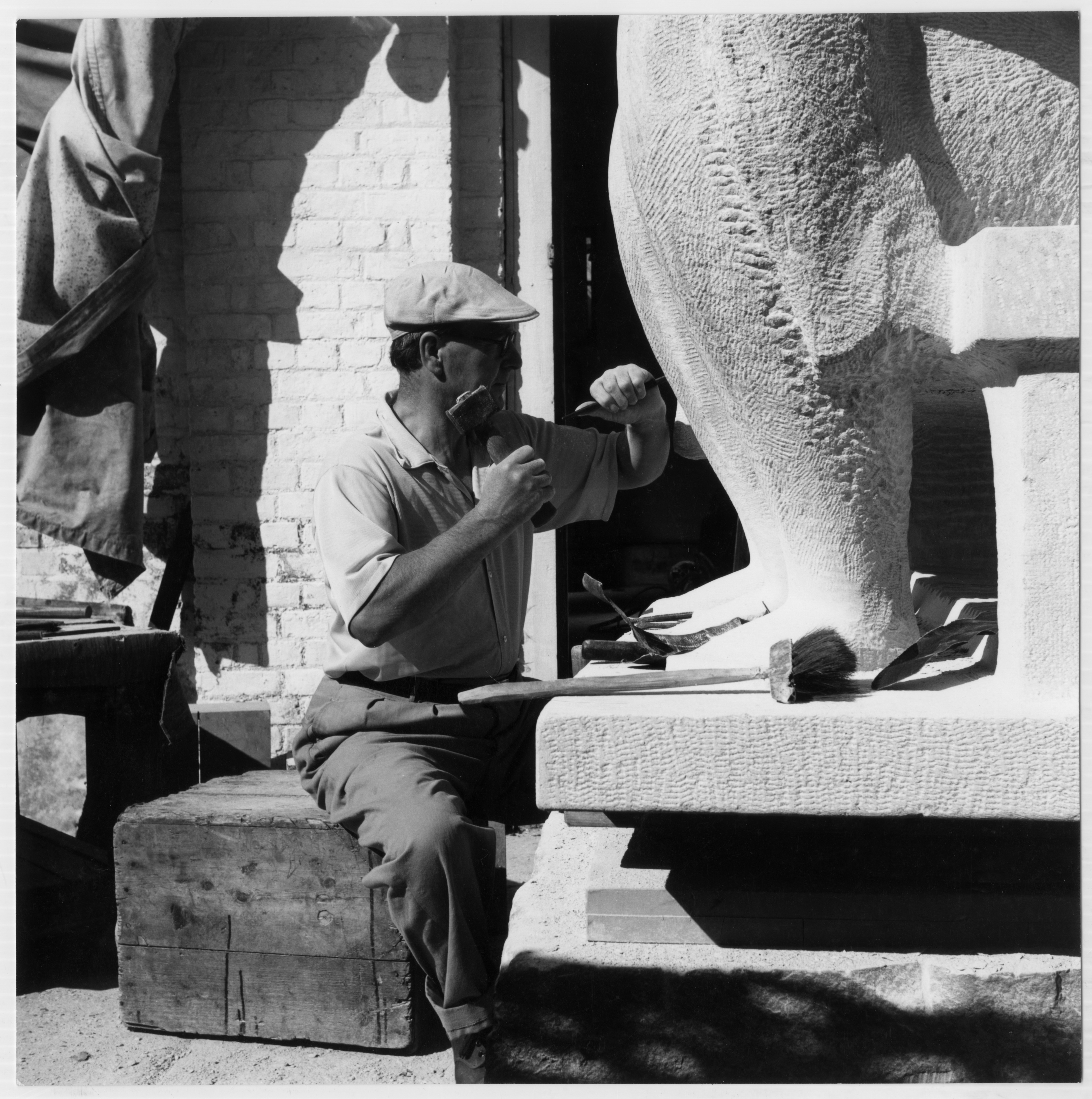 Henry Moore carving the Harlow Family Group sculpture, 1955