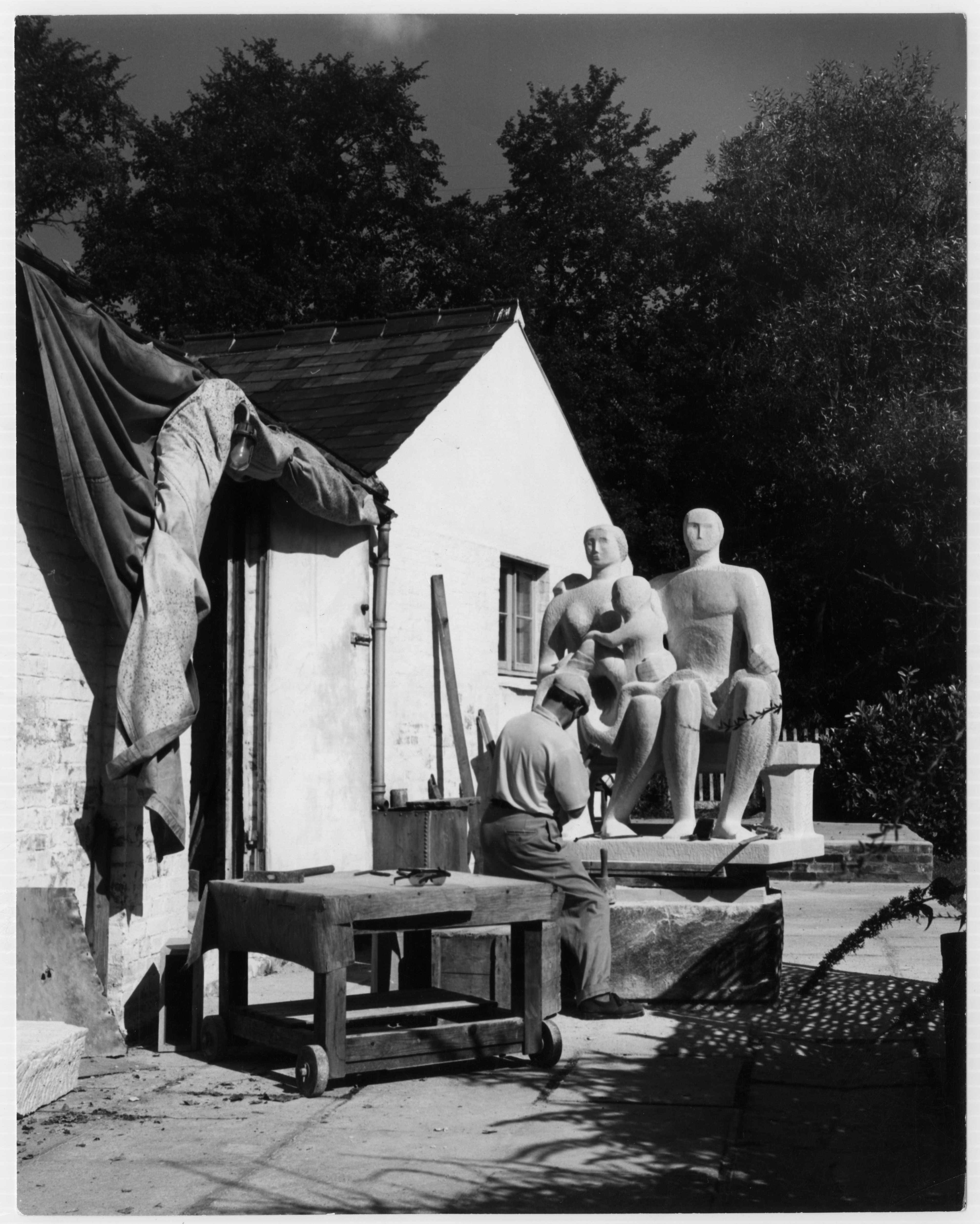 Henry Moore working on the Harlow Family Group sculpture, 1955