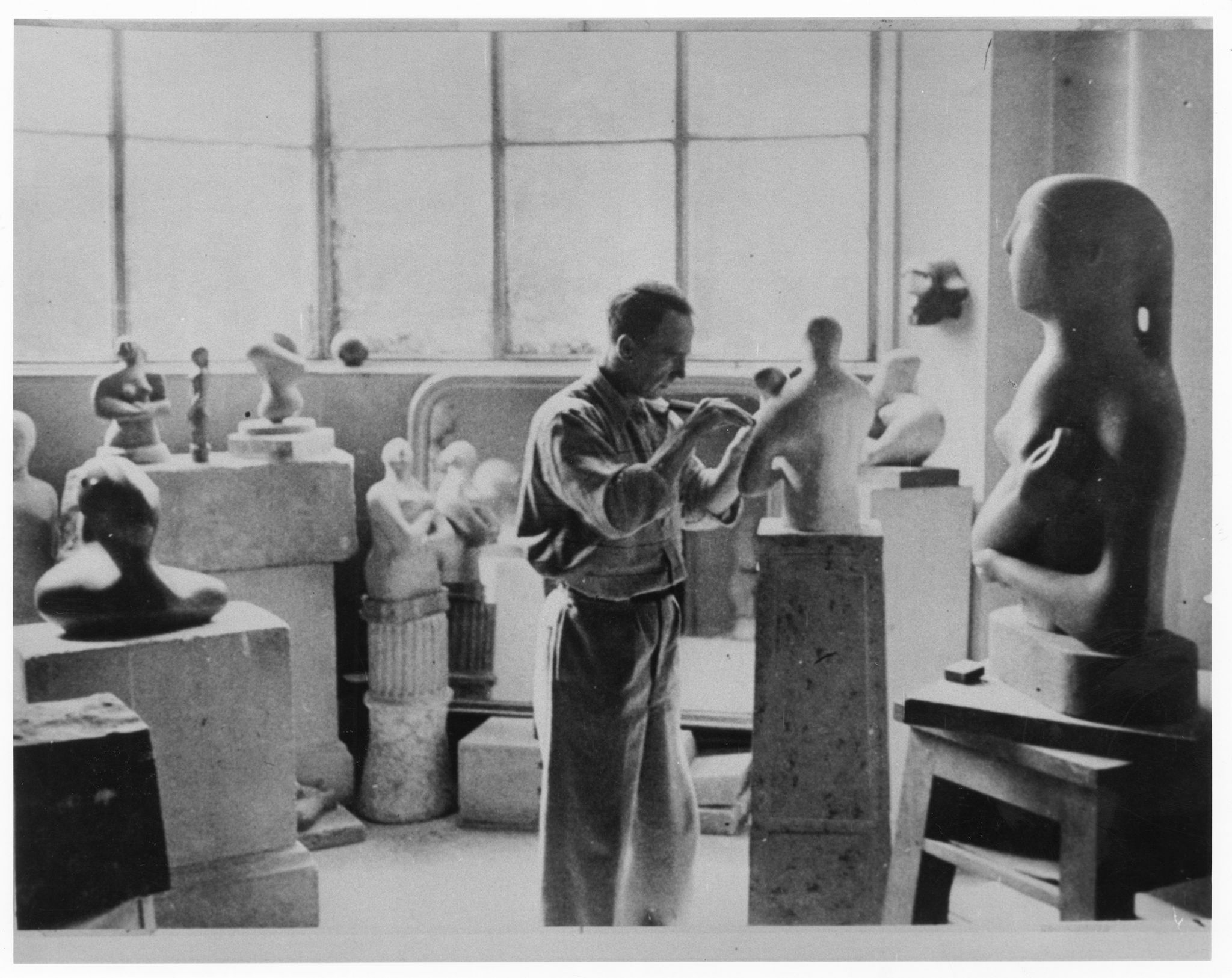 Henry Moore in the studio at 11a Parkhill Road, Hampstead, c.1933