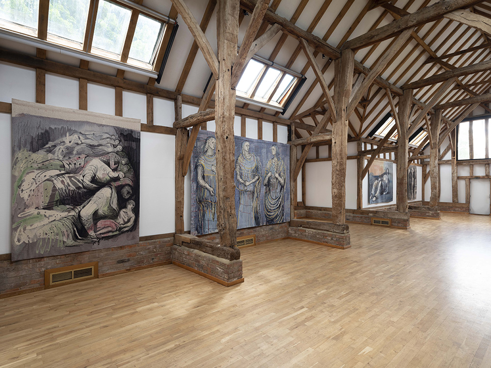 The Aisled Barn interior showing Henry Moore's tapestries.