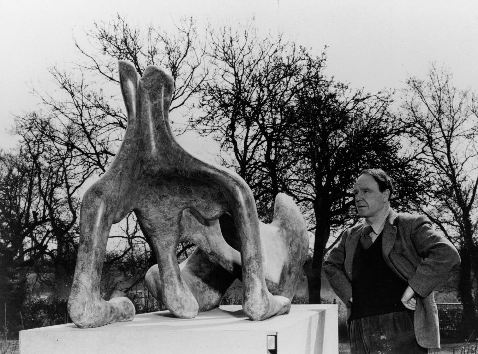 Henry Moore in the garden at Hoglands in front of Reclining Figure: Festival c.1950