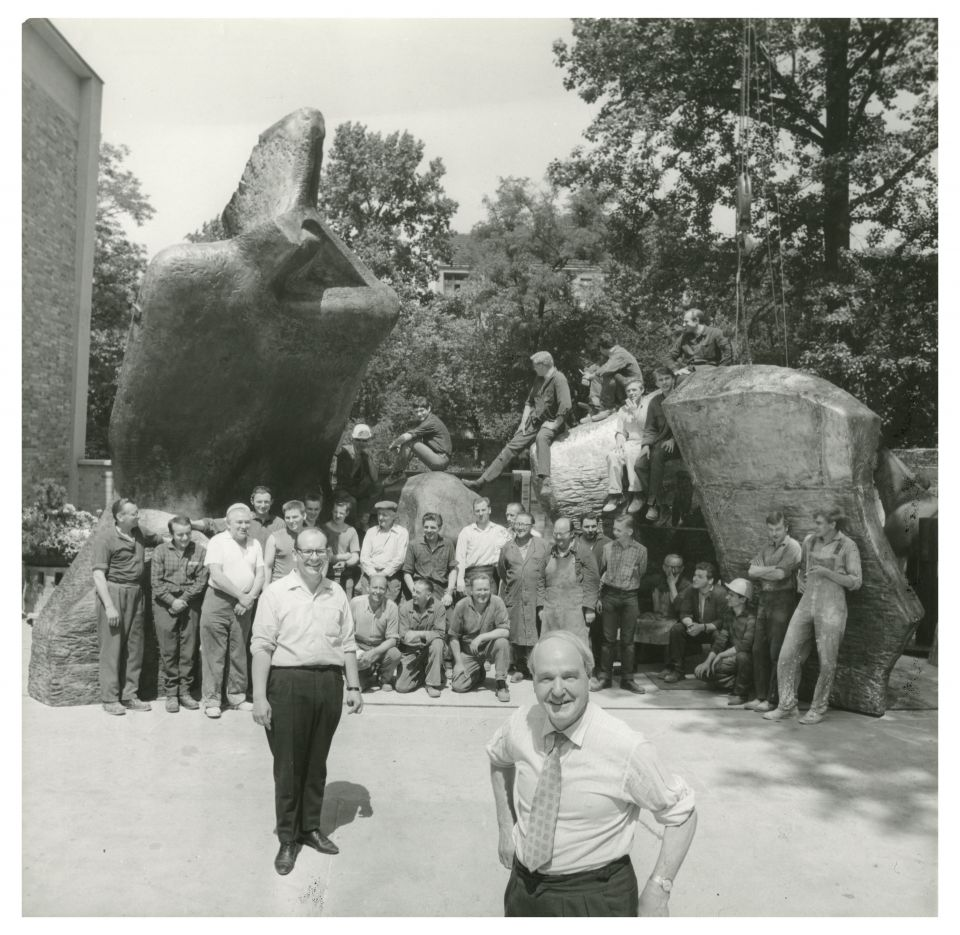 Henry Moore celebrating with Hermann Noack and others who worked at the Foundry after the completion of Lincoln Centre Reclining Figure (LH 519), c.1965
