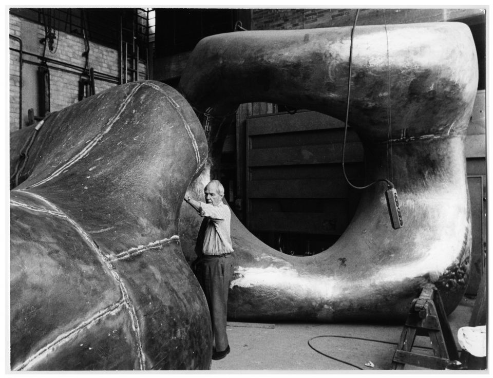 Henry Moore inspecting the progress on Large Two Forms (LH 556) at Noack's Foundry, c.1966