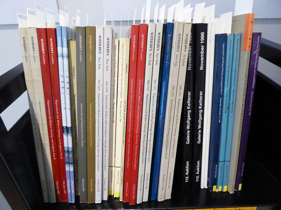 A selection of catalogues, shelved in the archive