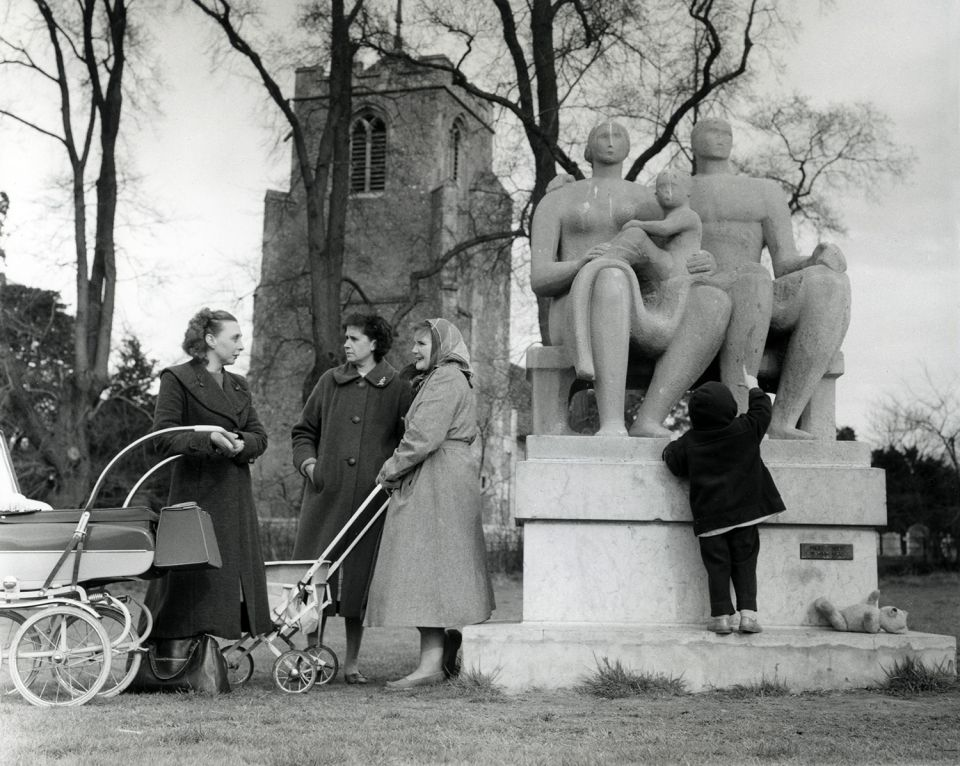 Women with prams and a young child by Harlow Family Group 1954-55 (LH 364) outside St. Mary-at-Latton church, Harlow.