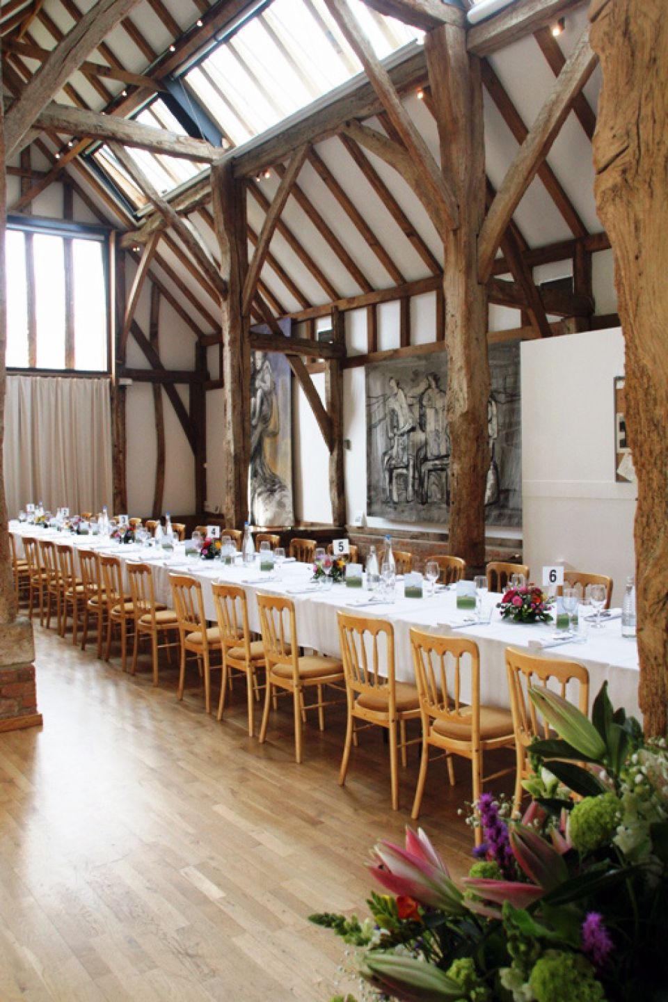 Aisled Barn laid with long table for a birthday party