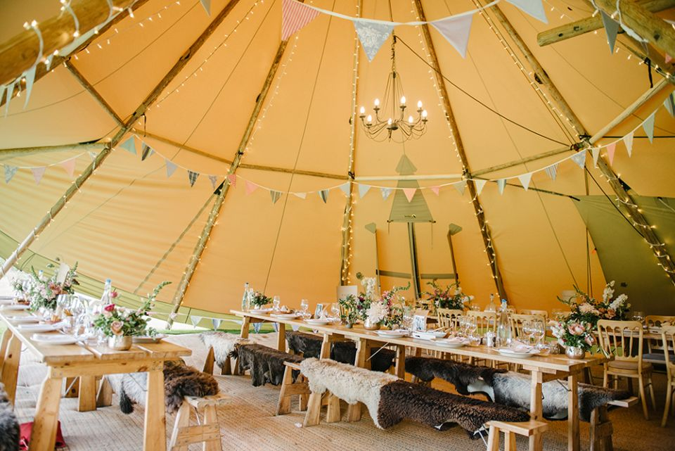 Tipi interior with bunting