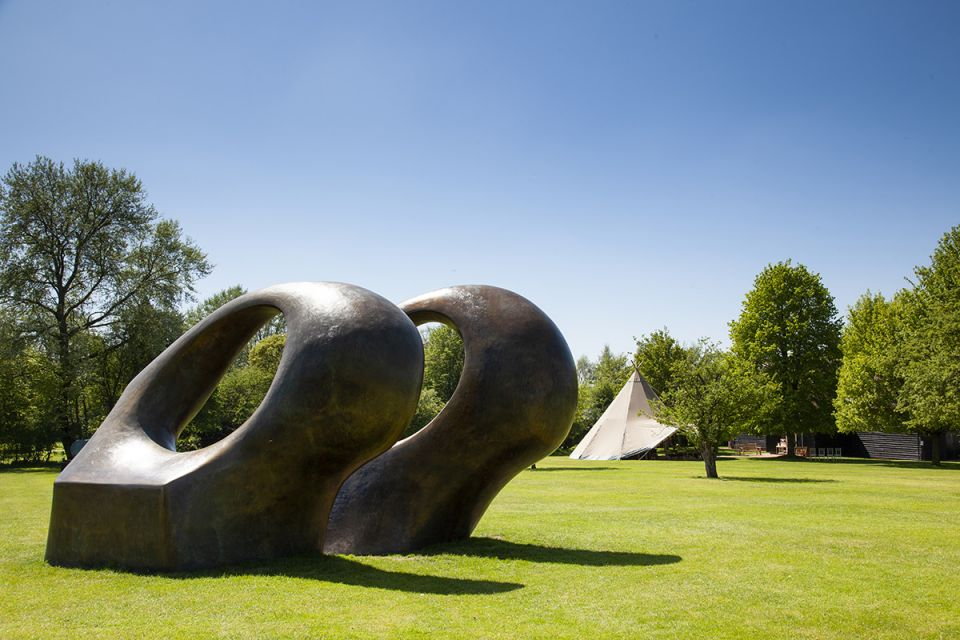 A tipi in the grounds with Henry Moore's 'Double Oval' 1966