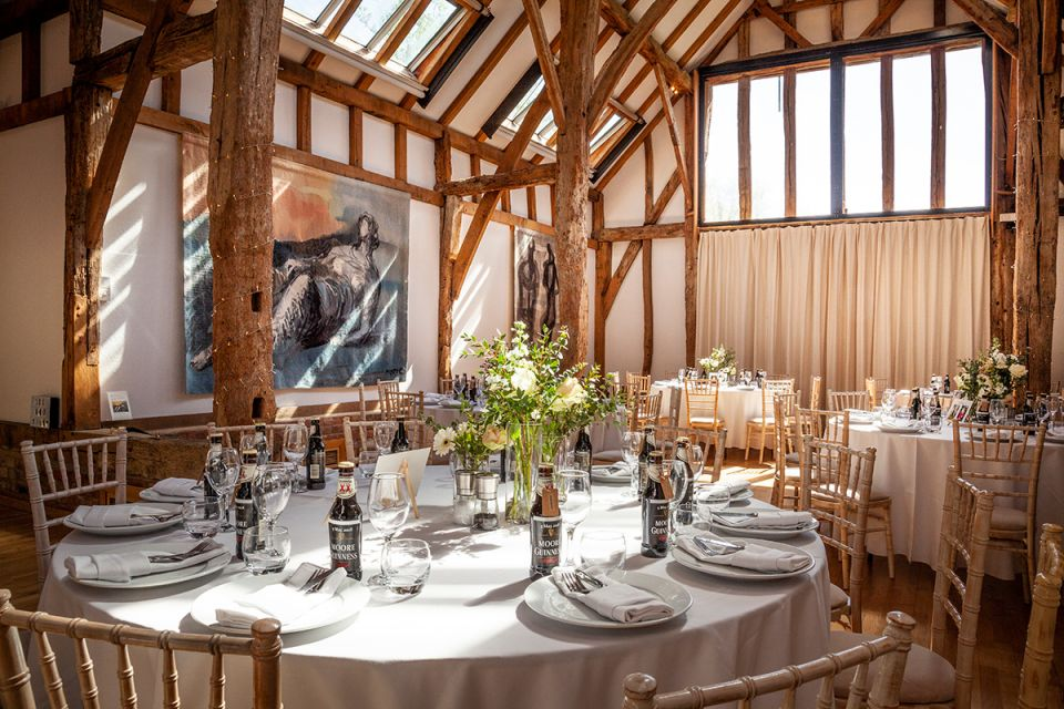 The Aisled Barn, laid for a wedding breakfast