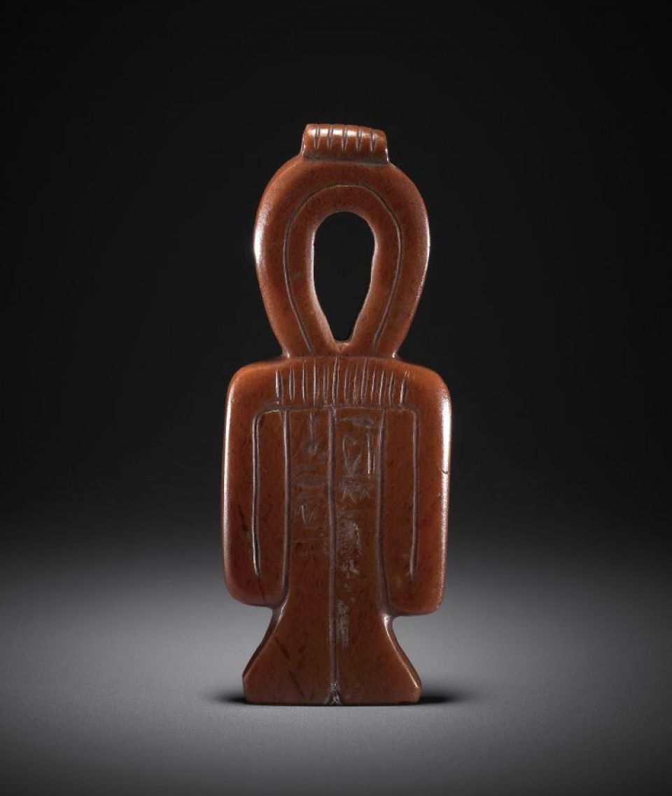 Red jasper 'thet'-girdle Egyptian amulet (c. 1250-1100 BC)