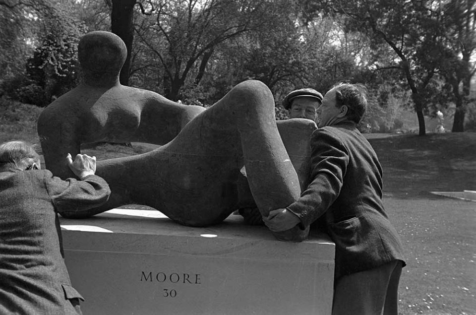Moore with 'Recumbent Figure' 1938 at the 'Open Air Exhibition of Sculpture' in Battersea Park, London 1948