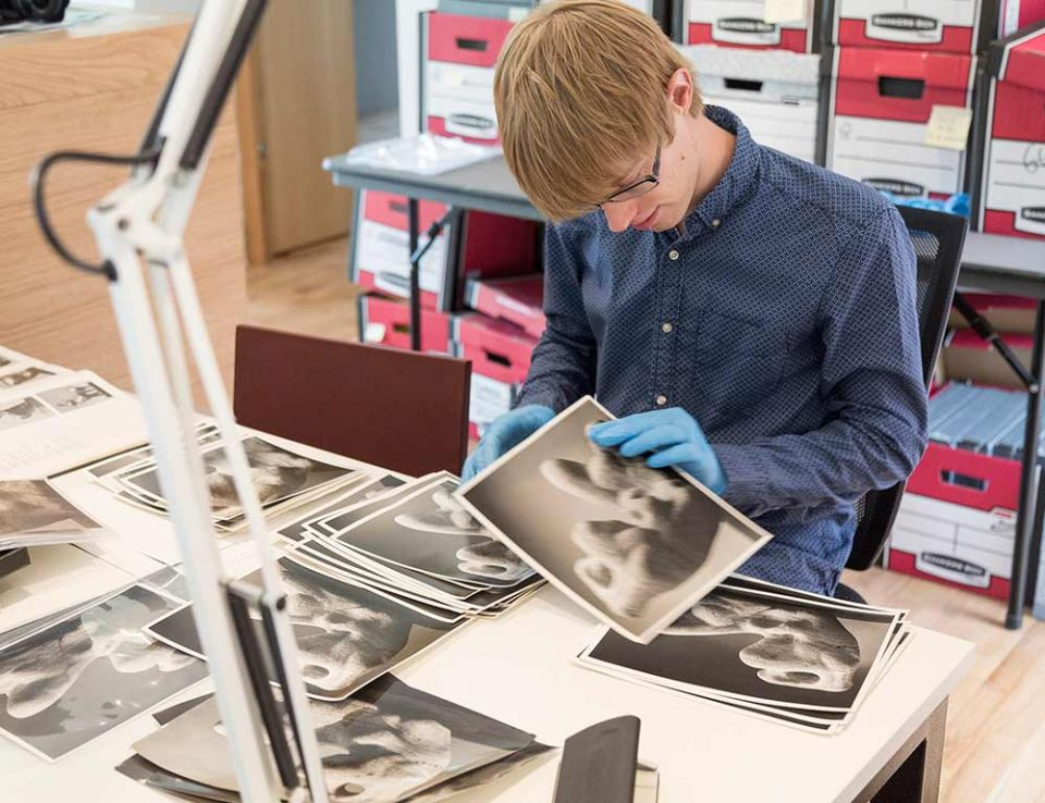 Image Licensing Assistant, Joe, working with some archive materials