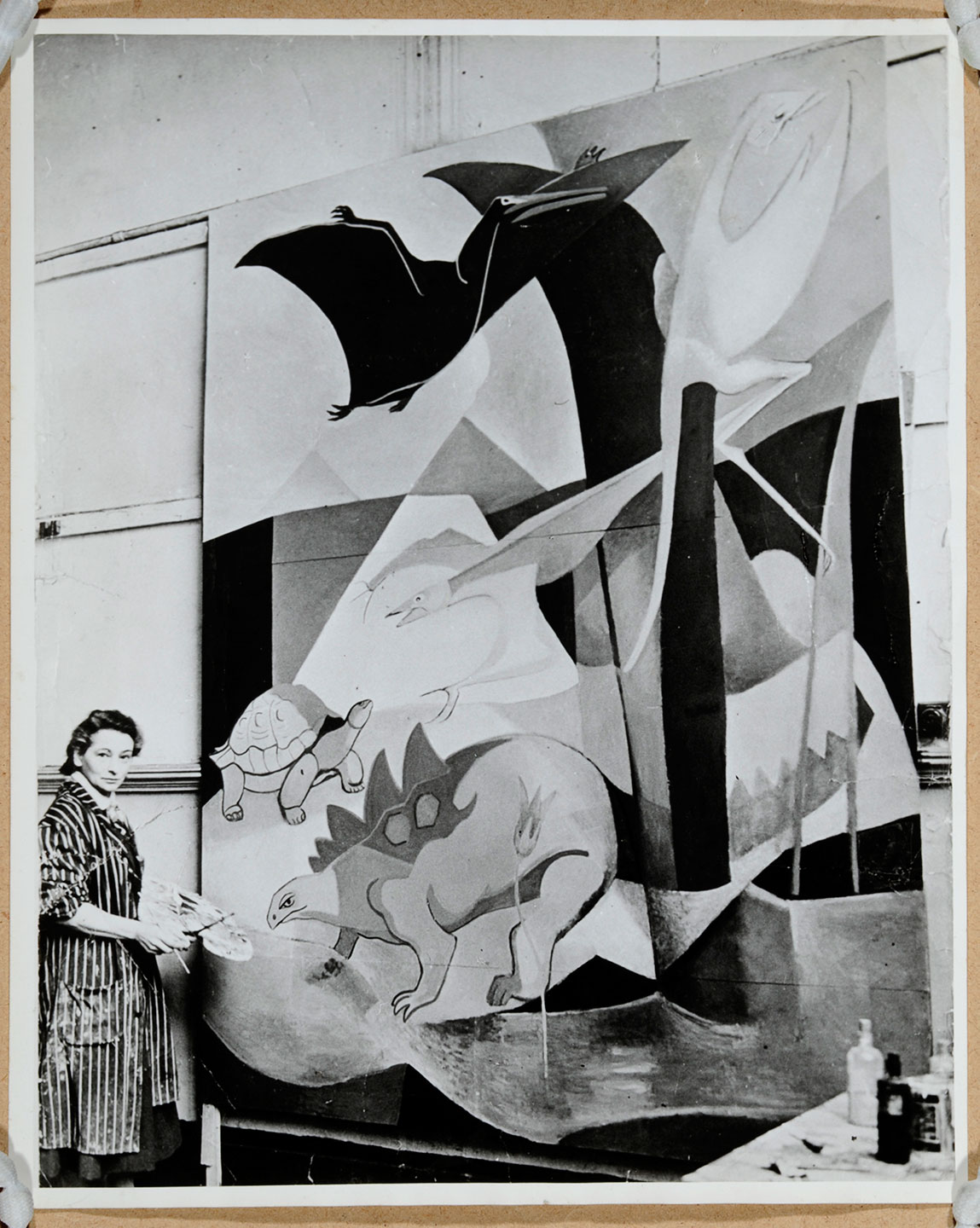 Photograph of Dorothy Annan working on her mural, 'The History of Flight', for Hatfield Junior School, Hertfordshire, 1940s