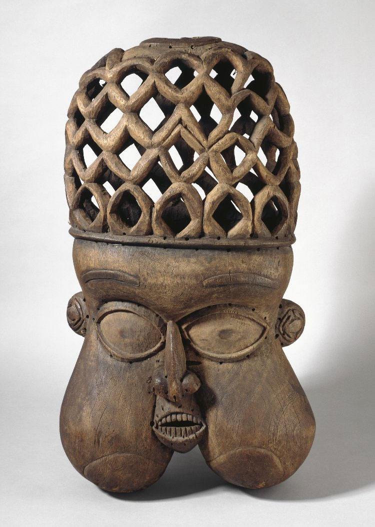 Wooden mask, large, with distended cheeks and openwork pattern on the head