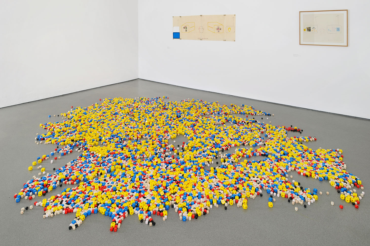Installation view of Gallery 3, showing 'Eins. Un. One.' (1984, 16,000 painted wooden cubes) 2