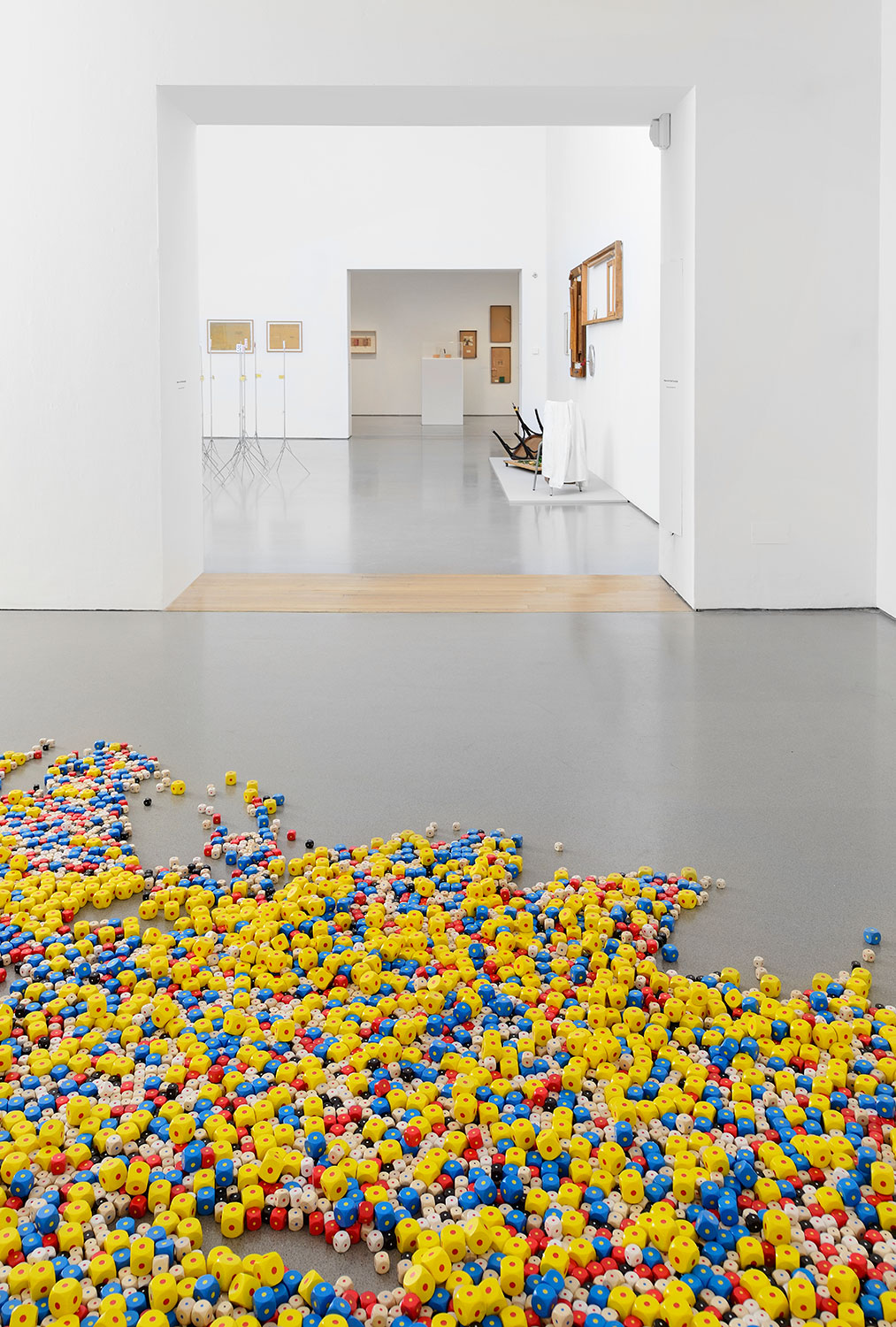 Installation view of Gallery 3, showing 'Eins. Un. One.' (1984, 16,000 painted wooden cubes) 3