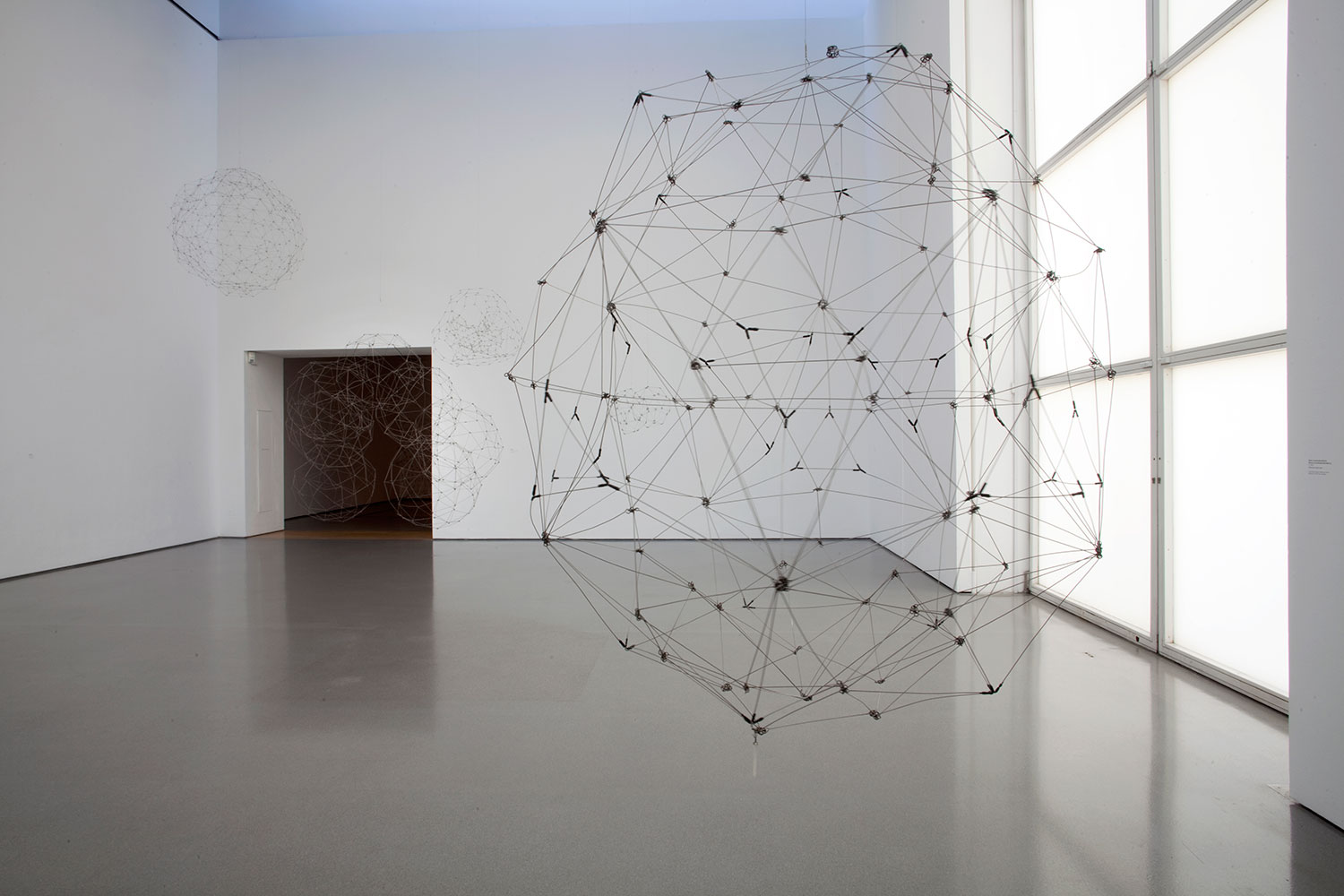 Installation view of Gallery 2, showing (foreground): Gego, 'Esfera N° 5' ('Sphere No. 5') (1977, steel wire with metal clasps)