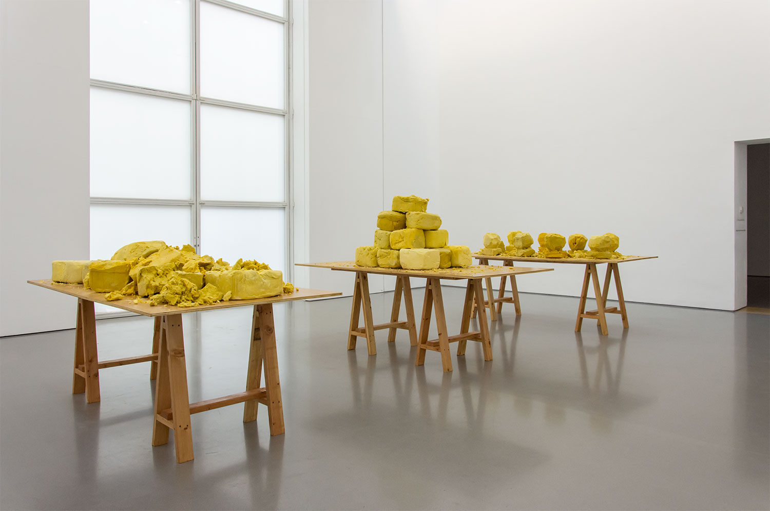 Rashid Johnson, Shea Butter Three Ways, 2019, shea butter, tables