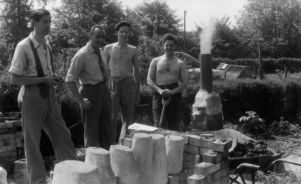 Henry Moore's assistants Oliffe Richmond, Alan Ingham, and Anthony Caro with the homemade Foundry in the garden of Hoglands, c. 1950