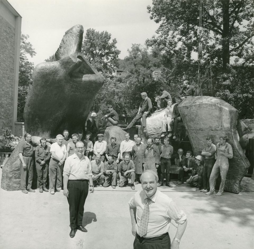 Henry Moore celebrating with Hermann Noack and others who worked at the Foundry after the completion of Lincoln Centre Reclining Figure (LH 519), c. 1965