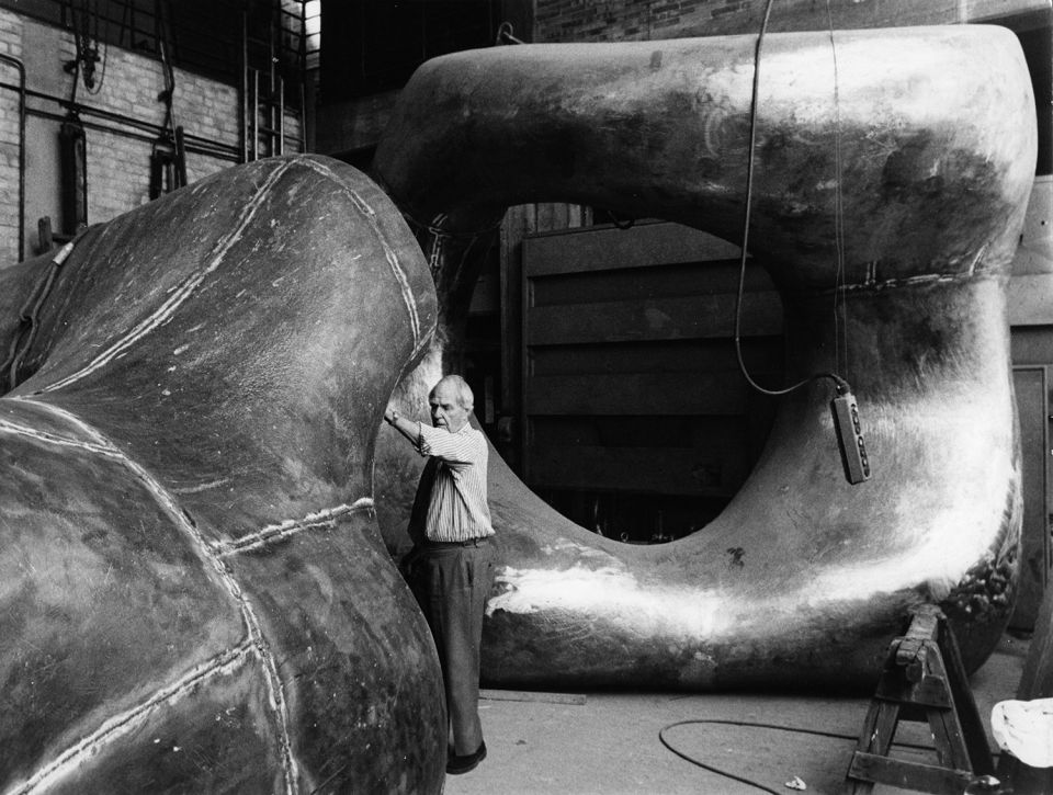 Henry Moore inspecting the progress on Large Two Forms (LH 556) at Noack's Foundry, c. 1966
