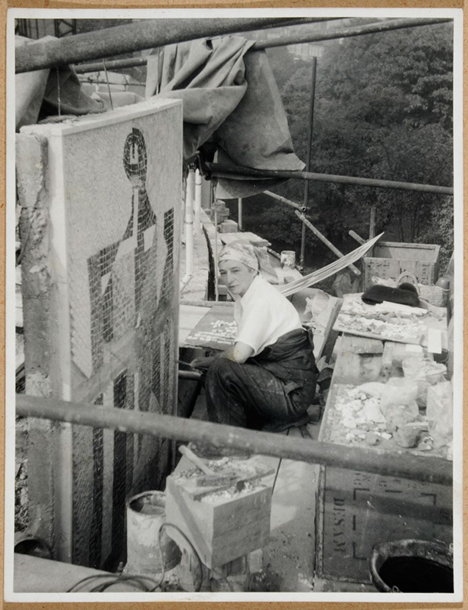 Photograph of Dorothy Annan working on the mosaic panels for King's College Library, Newcastle, 1959
