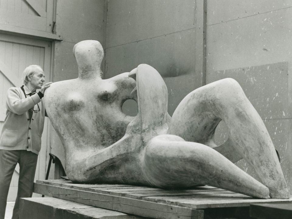 Henry Moore inspecting an artwork