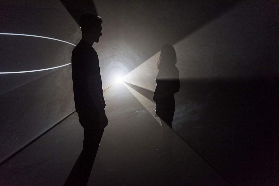 Visitors interact with Anthony McCall's 'Face to Face' (2013) at The Hepworth Wakefield