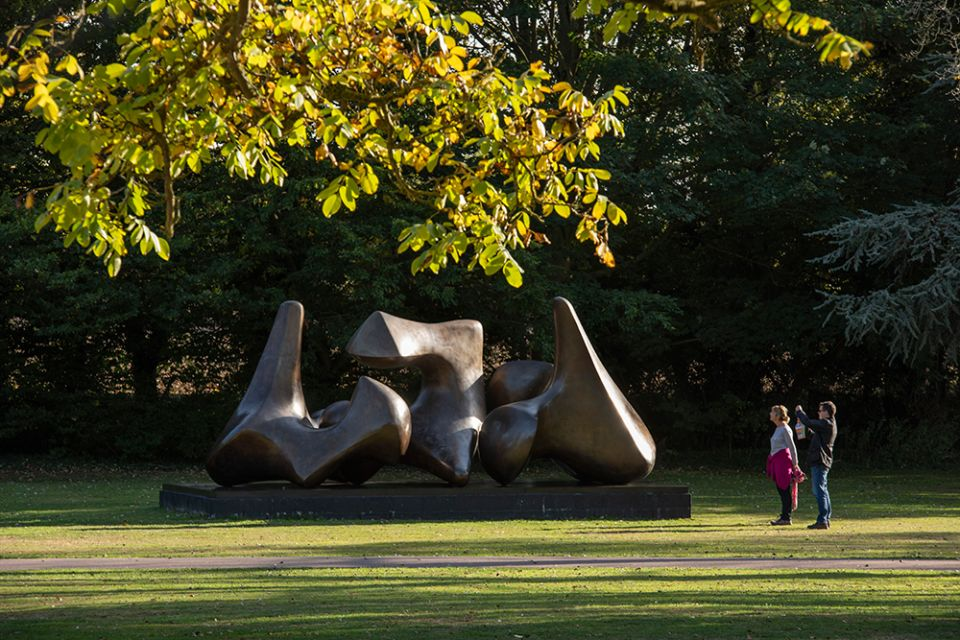 Henry Moore, 'Three Piece Sculpture: Vertebrae' with visitors