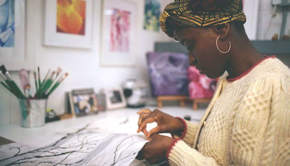 Enam Gbewonyo working in her studio