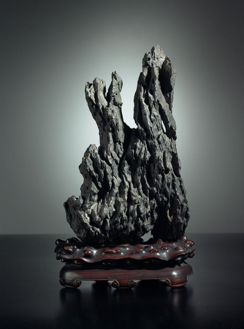 Lingbi Stone on old hardwood stand. China, Qing dynasty (1644-1911)