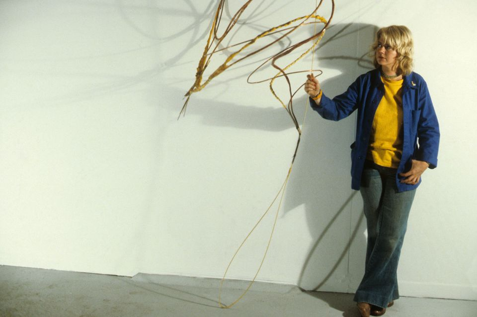 Shelagh Cluett standing next to 'Flux IV' (1979)