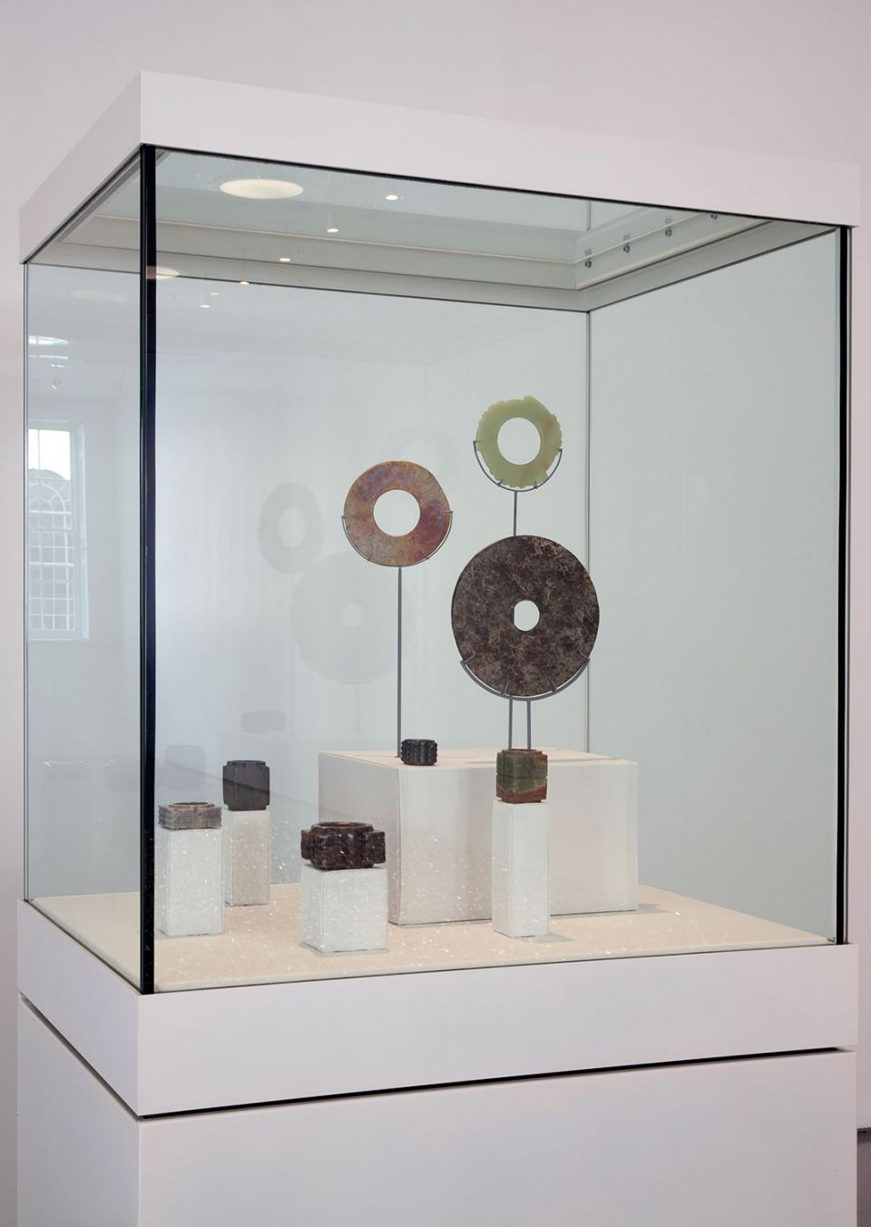 Installation view of Gallery 1, showing collection of jade bi and cong