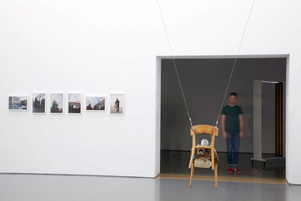 Installation view of Gallery 2, showing Roman Signer's 'Chair' (2014, wooden chair with motor, steel wire)