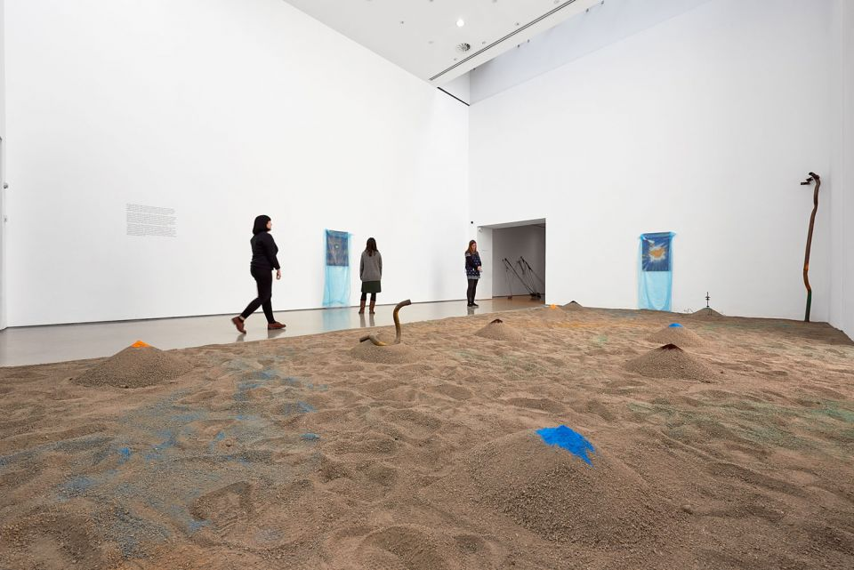 Installation view of Senga Nengudi, showing Sandmining, 2018, sand, coloured pigment, found objects