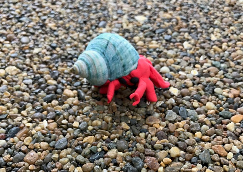 A hermit crab sculpted from a found shell