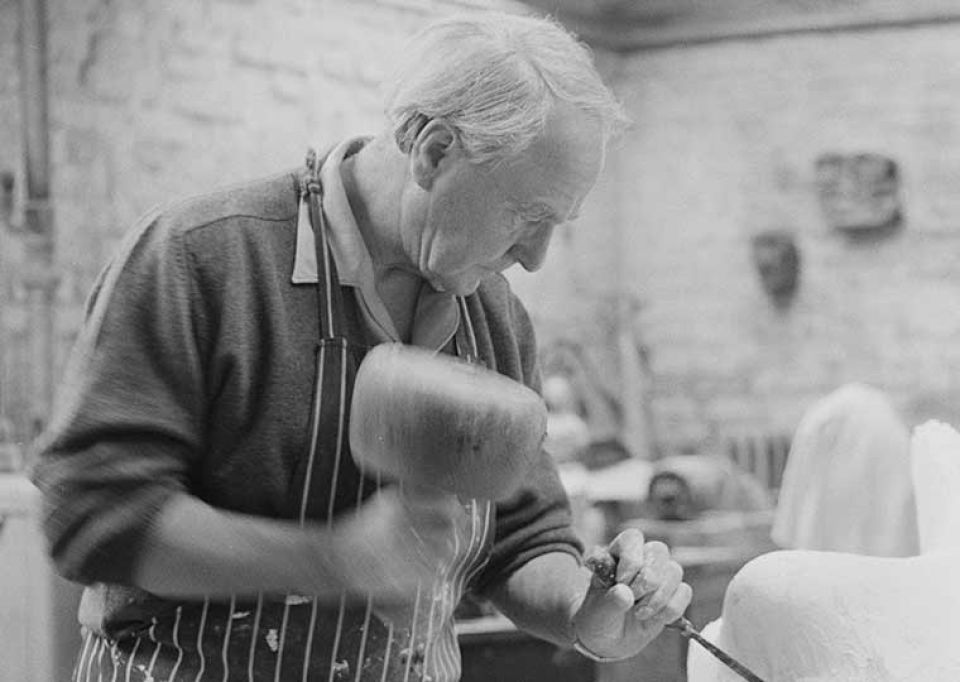 Henry Moore carving in his studio