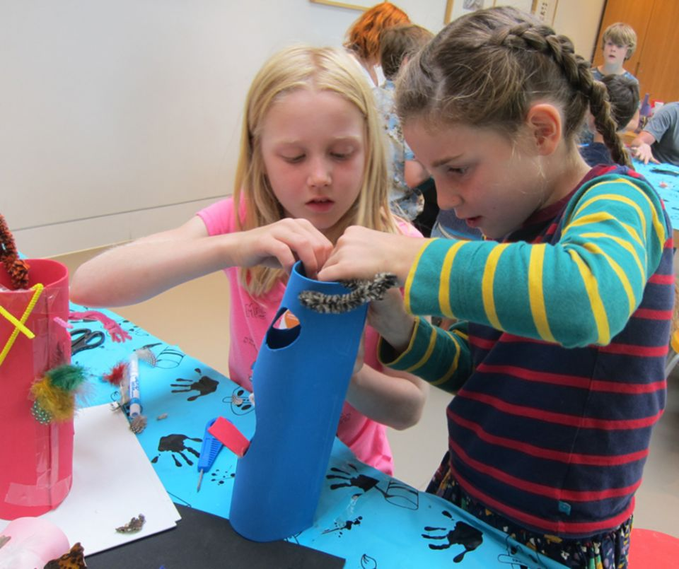 Two children making a sculpture at a 2018 workshop