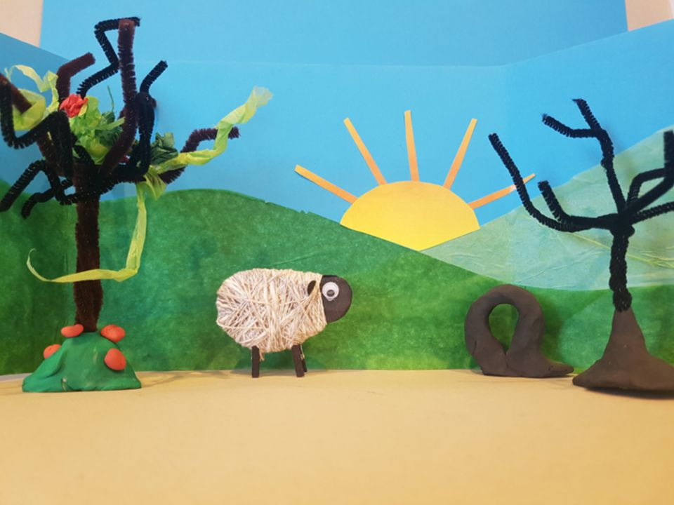 A mixed media diorama with mini sheep model