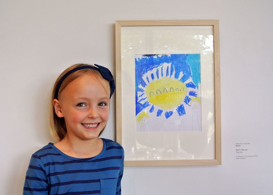 A photo of primary winner Tilly White with her drawing
